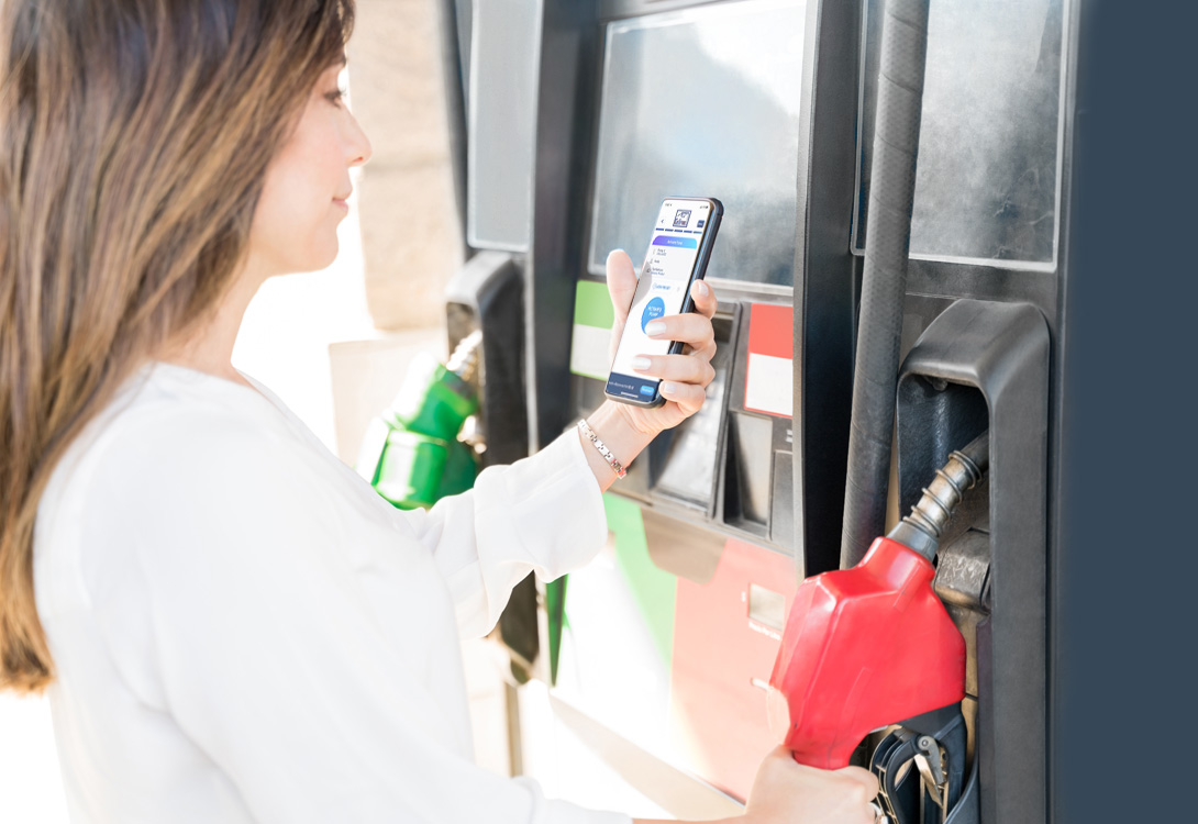 Lady at pump with CellFuell app
